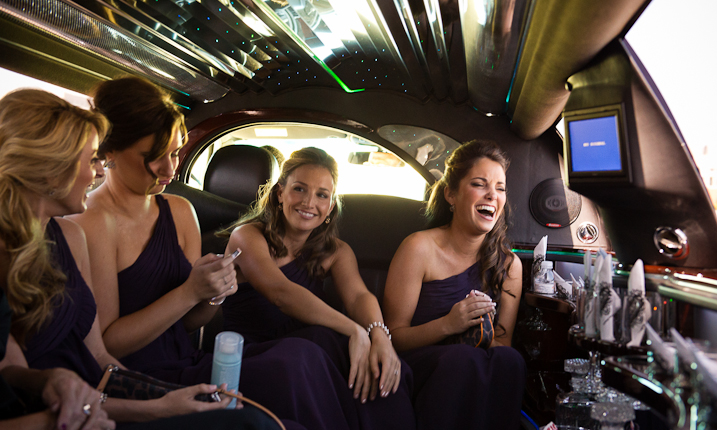 Bridesmaids Sitting In Limousine